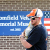 Home Depot employee Kyle Strain carries a bag of rocks to put around the tree in front of the Broomfield Veterans Memorial Museum on Thursday. <br /> <br /> May 17, 2012 <br /> staff photo/ David R. Jennings