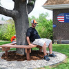 Home Depot employee Kyle Strain sits on the bench they built at the entrance of the Broomfield Veterans Memorial Museum on Thursday. <br /> <br /> May 17, 2012 <br /> staff photo/ David R. Jennings