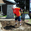 Home Depot employee Richard Collins works on the area at the entrance of the Broomfield Veterans Memorial Museum on Thursday. <br /> <br /> May 17, 2012 <br /> staff photo/ David R. Jennings