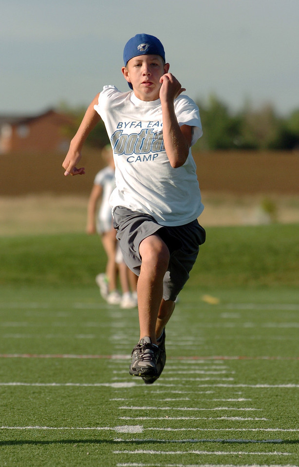 Nick Carvo, 13, runs down the hash marks to the fifty yard line during the Teen Boot Camp at Broomfield County Commons Park on Thursday.<br /> July 22, 2010<br /> Staff photo/ David R. Jennings