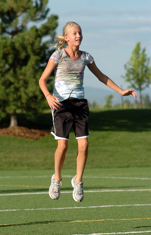 Caroline Adams, 11, jumps during the cardio section of the Teen Boot Camp at Broomfield County Commons Park on Thursday.<br /> July 22, 2010<br /> Staff photo/ David R. Jennings