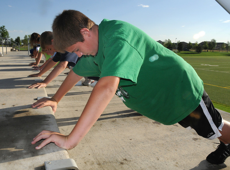 Alec Harris, 12,  does pushups during the Teen Boot Camp at Broomfield County Commons Park on Thursday.<br /> July 22, 2010<br /> Staff photo/ David R. Jennings