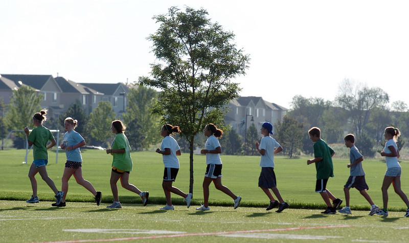 The group of teens runs around the championship field during the Teen Boot Camp at Broomfield County Commons Park on Thursday.<br /> July 22, 2010<br /> Staff photo/ David R. Jennings