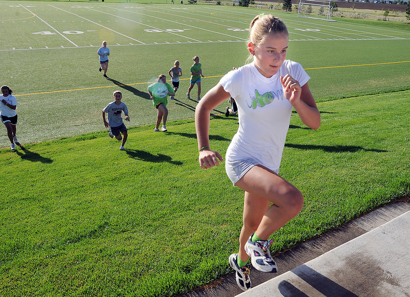 Madison Mueller, 12, runs up the hill after running across the field during the Teen Boot Camp at Broomfield County Commons Park on Thursday.<br /> July 22, 2010<br /> Staff photo/ David R. Jennings