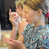 Layla Clark, 13, gets a bitter taste of an ingredient during the teen cooking session of making Mediterranean dishes with at the Mamie Doud Eisenhower Public Library on Tuesday.<br /> <br /> <br /> July 5 2011<br /> staff photo/ David R. Jennings