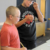 Paris Sitchler, 13, right, takes a taste of the dish he and his brother Val, 12, made during the teen cooking session of making Mediterranean dishes with at the Mamie Doud Eisenhower Public Library on Tuesday.<br /> <br /> <br /> July 5 2011<br /> staff photo/ David R. Jennings
