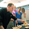 Chef Luke Zautke, Knife and Cork, checks how well the bread is done cooking during the teen cooking session of making Mediterranean dishes with at the Mamie Doud Eisenhower Public Library on Tuesday.<br /> <br /> July 5 2011<br /> staff photo/ David R. Jennings
