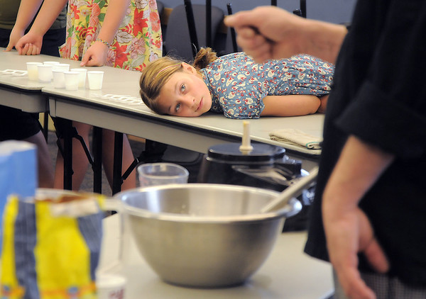Layla Clark, 13, listens to chef Luke Zautke talk while they wait for bread to rise during the teen cooking session of making Mediterranean dishes with at the Mamie Doud Eisenhower Public Library on Tuesday.<br /> <br /> <br /> July 5 2011<br /> staff photo/ David R. Jennings