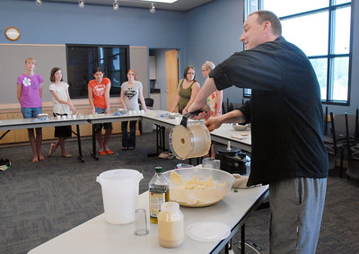 Knife and Cork chef Luke Zautke demonstrates how to make bread to the class during the teen cooking session of making Mediterranean dishes with at the Mamie Doud Eisenhower Public Library on Tuesday. July 5 2011 staff photo/ David R. Jennings