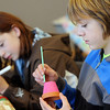 Eamon White , 12, right, decorates a little pot with his sister Alison, 11, during the Holiday Crafts for Teens program at Mamie Doud Eisenhower Public Library on Saturday.<br /> December 5, 2009<br /> Staff photo/David R. Jennings