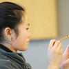 Holly Vuong, 12, decorates a little pot for a plant as a gift at the Holiday Crafts for Teens program at Mamie Doud Eisenhower Public Library on Saturday.<br /> December 5, 2009<br /> Staff photo/David R. Jennings