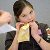 Bailey Estes, 12, uses her teeth to make a crease while making an oragami box during the Holiday Crafts for Teens program at Mamie Doud Eisenhower Public Library on Saturday.<br /> December 5, 2009<br /> Staff photo/David R. Jennings
