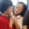 Monica Mah, 11, center, has her triplette sister Nicole try on a wool beaded necklace Monica made as Bailey Estes, 12, watches at right during the Holiday Crafts for Teens program at Mamie Doud Eisenhower Public Library on Saturday.<br /> December 5, 2009<br /> Staff photo/David R. Jennings