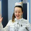Michaela Peters, 13, balances an oragami box on her head during the Holiday Crafts for Teens program at Mamie Doud Eisenhower Public Library on Saturday.<br /> December 5, 2009<br /> Staff photo/David R. Jennings
