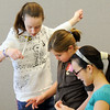 Michaela Peters, 13, left, Bailey Estes, 12, and Vi Vuong, 14, begin making beaded necklaces during the Holiday Crafts for Teens program at Mamie Doud Eisenhower Public Library on Saturday.<br /> December 5, 2009<br /> Staff photo/David R. Jennings