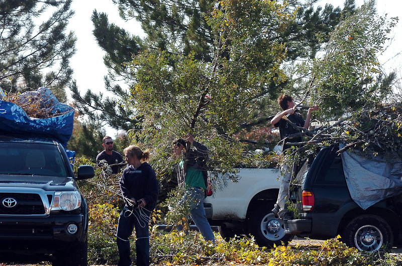 Broomfield residents put their broken tree branches onto the pile at the special drop-off center in the parking lot of the Bay Aquatic Park, 250 Lamar St. on Friday. The special drop-off center is open from 7 a.m. to 5 p.m. daily through November 6.<br /> <br /> October 28, 2011<br /> staff photo/ David R. Jennings