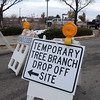 Signs direct Broomfield residents to the temporary tree branch drop off in the parking lot of the Bay Aquatic Center on Saturday.<br /> October 29, 2011<br /> staff photo/ David R. Jennings