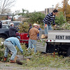 Broomfield residents unload their broken branches at the second pile of the temporary tree branch drop off in the parking lot of the Bay Aquatic Center on Saturday.<br /> October 29, 2011<br /> staff photo/ David R. Jennings