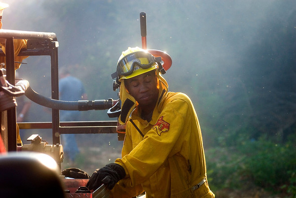Texas Wildfires.JPEG-0a792.JPG A Maud, Texas firefighter closes his eyes to avoid fire debris during a 7,000 acre fire in southern Cass County, Texas Monday, Sept. 5, 2011. (AP Photo/The Texarkana Gazette, Christena Dowsett)