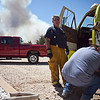Texas Wildfires.JPEG-0b623.JPG Kevin Giesalhart, fire chief of neighboring Five Points Fire Department, prepares to head to the scene of a wildfire in  in Bastrop County, Texas  on Monday, Sept. 5, 2011.    A roaring wildfire raced unchecked Monday through rain-starved farm and ranchland in Texas, destroying nearly 500 homes during a rapid advance fanned in part by howling winds from the remnants of Tropical Storm Lee.   (AP Photo/The Daily Texan, Trent Lesikar )