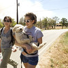 Texas Wildfires.JPEG-00a84.JPG Paula Wilson, left, and her sister Monica Wilson walk along Tahitian Drive in Bastrop, Texas, after rescuing  their father's dog, Homer, on Monday Sept. 5, 2011.  Their father was forced to evacuate from his home as fire neared the area. A roaring wildfire raced unchecked Monday through rain-starved farm and ranchland in Texas, destroying nearly 500 homes during a rapid advance fanned in part by howling winds from the remnants of Tropical Storm Lee. (AP Photo/Austin American-Statesman, Jay Janner)  MAGS OUT; NO SALES; TV OUT; INTERNET OUT EXCEPT FOR AP MEMBERS