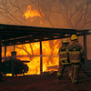 Texas Wildfires .JPEG-0f8f2.JPG Firefighters from Smithville Fire Department battle a large wildfire on Highway 71 near Smithville, Texas, Monday, Sep. 5, 2011.  A roaring wildfire raced unchecked Monday through rain-starved farm and ranchland in Texas, destroying nearly 500 homes during a rapid advance fanned in part by howling winds from the remnants of Tropical Storm Lee. (AP Photo/Erich Schlegel)