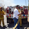 Texas Wildfires.JPEG-021aa.JPG Jeffery Whited, a volunteer, helps fire fighters hook up a hose to their tank trunk before they head out to fight the wildfire raging through Bastrop County, Texas  on Monday, Sept. 5, 2011.    A roaring wildfire raced unchecked Monday through rain-starved farm and ranchland in Texas, destroying nearly 500 homes during a rapid advance fanned in part by howling winds from the remnants of Tropical Storm Lee.   (AP Photo/The Daily Texan, Trent Lesikar )