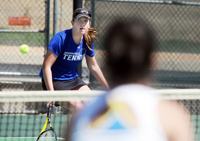 Broomfield's Dayna DeMeritte returns the ball to Mullen's Aimee Casias during the 4th Annual Broomfield Invitaional at the Broomfield Swim and Tennis club on Friday.   April 20, 2012  staff photo/ David R. Jennings