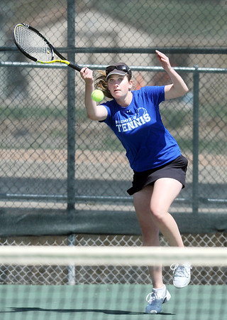 Broomfield's Dayna DeMeritte returns the ball to Mullen's Aimee Casias during the 4th Annual Broomfield Invitaional at the Broomfield Swim and Tennis club on Friday.<br /> <br /> <br /> April 20, 2012 <br /> staff photo/ David R. Jennings