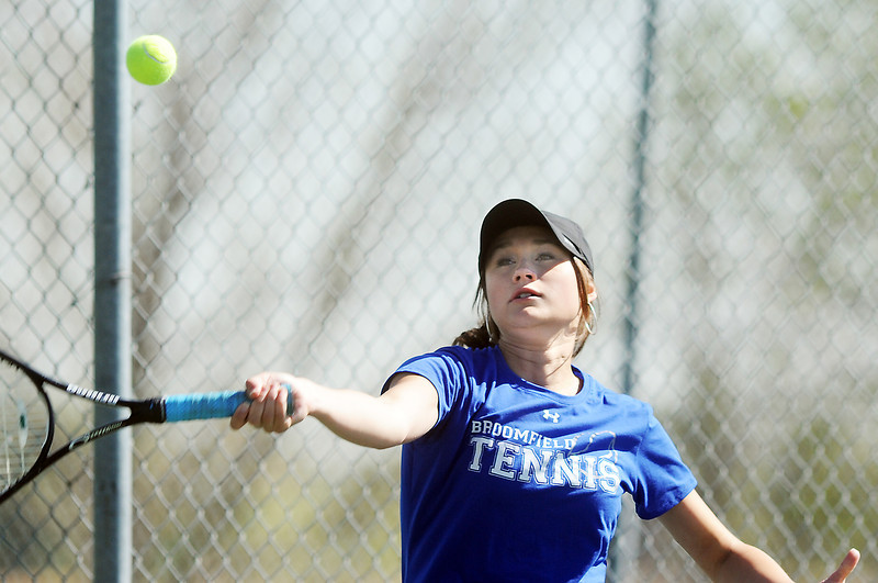 Broomfield's Madi Subry returns the ball to Boulder's Azalee Rafii during the 4th Annual Broomfield Invitaional at the Broomfield Swim and Tennis club on Friday.<br /> <br /> April 20, 2012 <br /> staff photo/ David R. Jennings