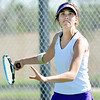 Boulder's Azlee Rafii returns the ball to Broomfield's Madi Subry during the 4th Annual Broomfield Invitaional at the Broomfield Swim and Tennis club on Friday.<br /> <br /> <br /> April 20, 2012 <br /> staff photo/ David R. Jennings