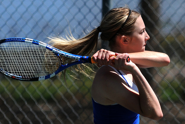 Broomfield's Katie Chrisman returns the ball to Arvada West's Sam Yacano during the 4th Annual Broomfield Invitaional at the Broomfield Swim and Tennis club on Friday.<br /> <br /> <br /> April 20, 2012 <br /> staff photo/ David R. Jennings