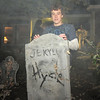 Fox Anderson, 13, poses with a Jekyll and Hyde tombstone made by his Uncle Scott in the graveyard of his family's Halloween display on Maria Circle in Brandywine on Thursday. October 20, 2011<br /> staff photo/ David R. Jennings