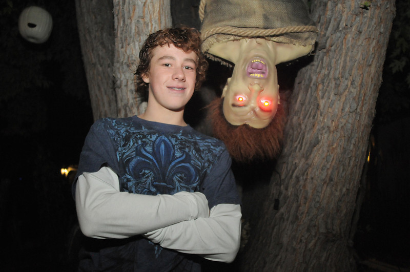 Fox Anderson, 13, poses with a character hanging from the front yard tree for his family's Halloween display on Maria Circle in Brandywine on Thursday. <br /> October 20, 2011<br /> staff photo/ David R. Jennings