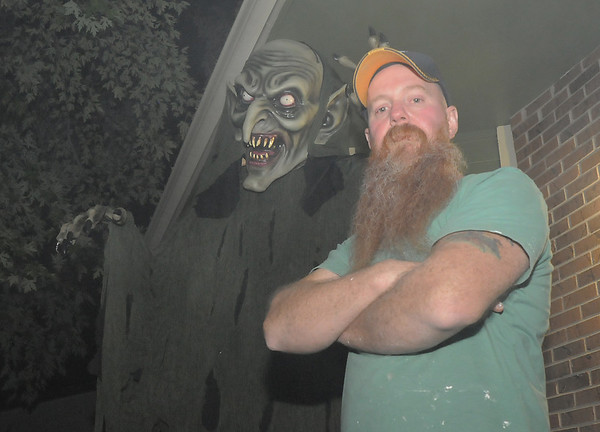 Peter Anderson stands near a scary character at the entrance to the family's Halloween display on Maria Circle in Brandywine on Thursday. <br /> October 20, 2011<br /> staff photo/ David R. Jennings