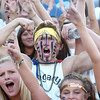 "Legacy senior Wyatt Swicegood, center, cheers with the Lightning fans during Friday's ""Backyard Brawl"" Legacy vs. Broomfield at North Stadium.<br /> <br /> September 9, 2011<br /> staff photo/ David R. Jennings"