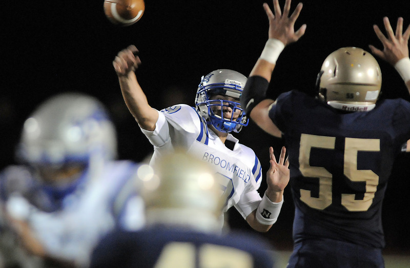"Broomfield's quarterback Angelo Perez throws a pass over Legacy's Mike Blascoe during Friday's ""Backyard Brawl"" Legacy vs. Broomfield at North Stadium.<br /> <br /> September 9, 2011<br /> staff photo/ David R. Jennings"