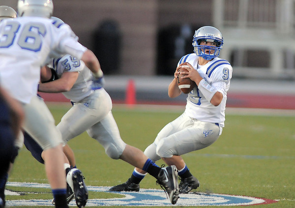 "Broomfeild's quarterback Angelo Perez looks for an open player during Friday's ""Backyard Brawl"" Legacy vs. Broomfield at North Stadium.<br /> <br /> September 9, 2011<br /> staff photo/ David R. Jennings"