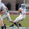 """Broomfeild's quarterback Angelo Perez looks for an open player during Friday's """"Backyard Brawl"""" Legacy vs. Broomfield at North Stadium.<br /> <br /> September 9, 2011<br /> staff photo/ David R. Jennings"""