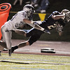 "Legacy's Cameron McWee leaps for the goal line however landing short with Broomfield's Lee Cannon during Friday's ""Backyard Brawl"" Legacy vs. Broomfield at North Stadium.<br /> <br /> September 9, 2011<br /> staff photo/ David R. Jennings"