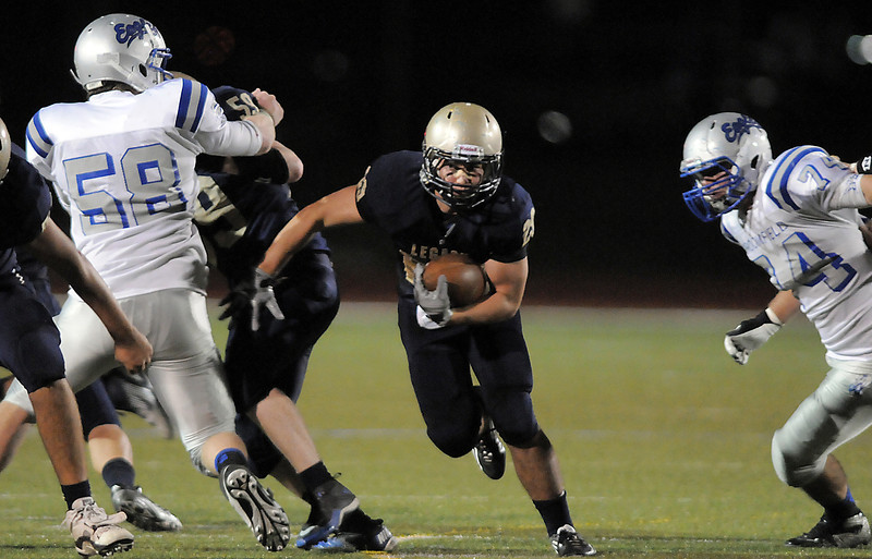 "Legacy's Eddie Schroder carries the ball through a hole in the line during Friday's ""Backyard Brawl"" Legacy vs. Broomfield at North Stadium.<br /> <br /> September 9, 2011<br /> staff photo/ David R. Jennings"