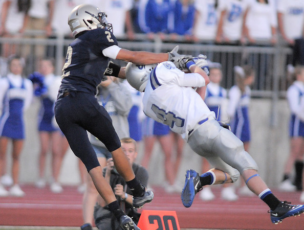 "Broomfield's Parker Oliver catches a pass with Legacy's Cameron McWee trying to break up the pass during Friday's ""Backyard Brawl"" Legacy vs. Broomfield at North Stadium.<br /> <br /> September 9, 2011<br /> staff photo/ David R. Jennings"