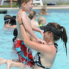 Michaela Cavanaugh tosses her son Dario McCormick, 10, in the air while they play in the pool at The Bay Aquatic Center
