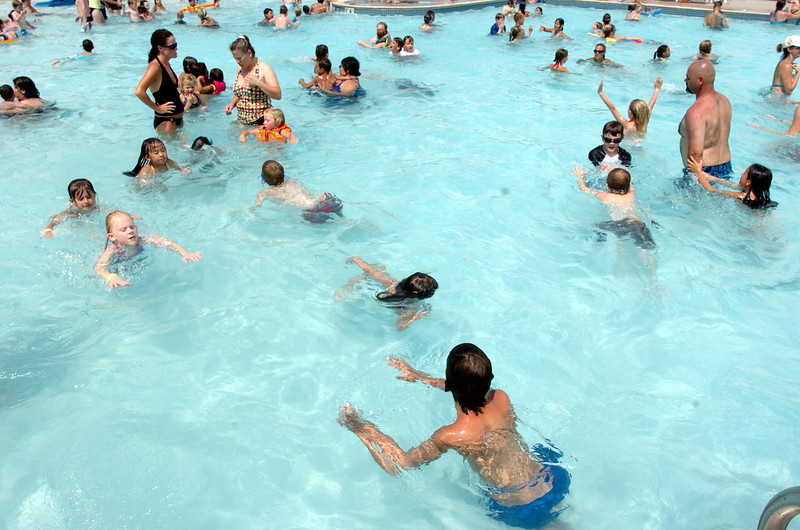 Children and adults play in the water at The Bay Aquatic Center.