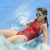 Kelsey Taylor, 12, hits the water at the bottom of a slide while playing at The Bay Aquatic Center.