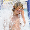 Carson Garnett, 10, stands in the waterfall while playing at The Bay Aquatic Center.