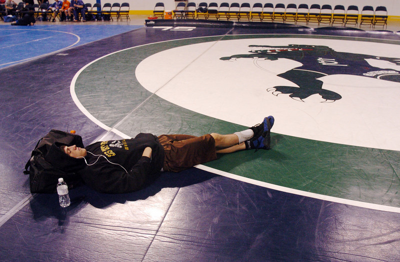 Broomfield's Jordan Gutierrez relaxes between bouts during Saturday's The Beast Wrestling Tournament at the Odeum Colorado.<br /> January 30, 2010<br /> Staff photo/David R. Jennings
