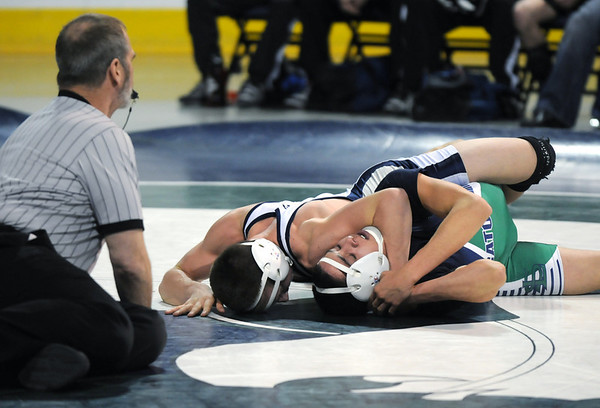 Broomfield's Nick Babcock pins  Standley Lake's Joe Solano in the 130lb. bout  during Saturday's The Beast Wrestling Tournament at the Odeum Colorado.<br /> January 30, 2010<br /> Staff photo/David R. Jennings