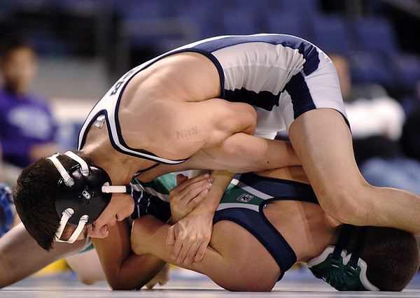 Broomfield's Mike Fargosa tries to pin Standley Lake's Colton Olson during the 112 lb. bout at Saturday's The Beast Wrestling Tournament at the Odeum Colorado.<br /> January 30, 2010<br /> Staff photo/David R. Jennings