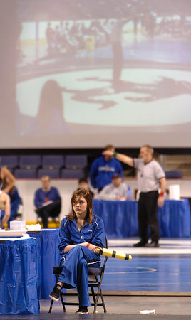 Broomfield High Pom Abbey Kochevar waits to signal when time is up during a bout with another bout projected on the screen in back at Saturday's The Beast Wrestling Tournament at the Odeum Colorado.<br /> January 30, 2010<br /> Staff photo/David R. Jennings